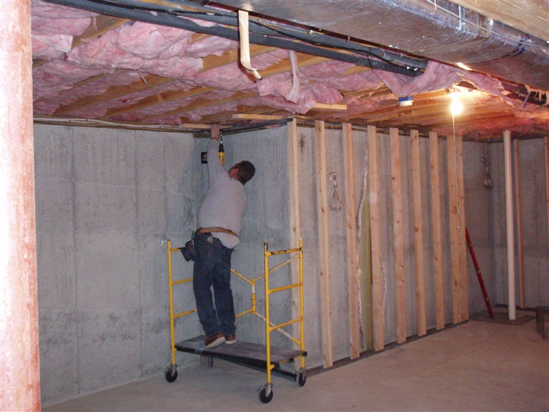 Basement Wall Framing egress window | stonecraft | insulation | gutters | shutters